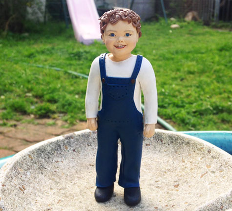 realistic boy polymer clay figurine and cake topper